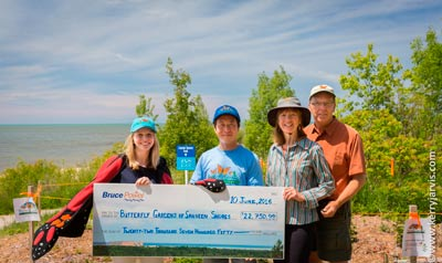 Emily Johnston, Bruce Power Senior Technical Officer in Environment & Sustainability, Francis Chua, Bruce Power Manager of Environment & Sustainability, Melitta Smole, co-founder of Butterfly Gardens of Saugeen Shores and Kerry Jarvis, co-founder of Butterfly Gardens of Saugeen Shores.