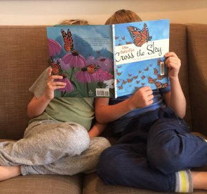 Two Children Reading a Butterfly Book