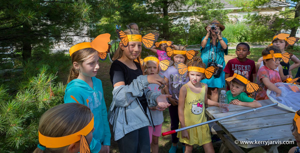 Kids Tagging a Monarch Butterfly Photo 1