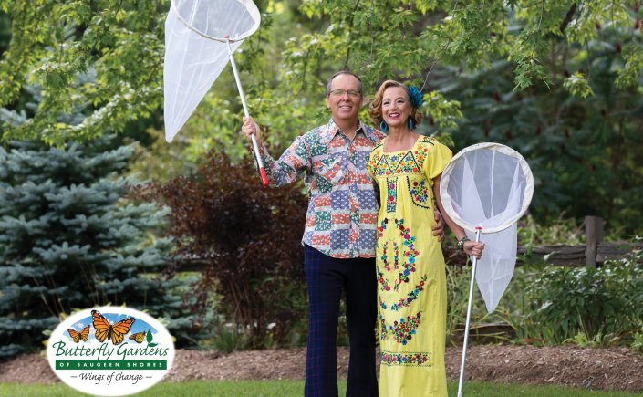 Kerry and Melitta dressed in retro outfits posing with butterfly nets.